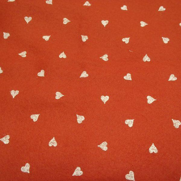 pannolenci arancione con cuori bianchi 45x50 cm